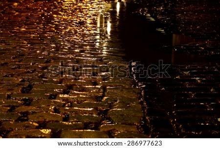 Cobbled street night rain