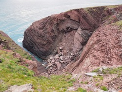Cobblers Hole, St. Anns Head, and the splendid anticline and syncline fold couplet in the Devonian-age Old Red Sandstone rock, south Pembrokeshire coast, Wales, UK