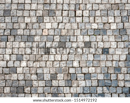 Cobbles. Abstract full frame background texture of marble cobble stones in the Old Town district of Prague, Czech Republic.