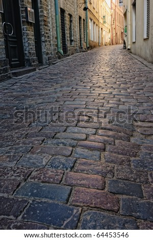 Cobblestone pavement in the narrow street in old town