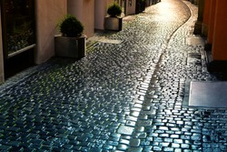 Cobblestone Road with Sunlight . Narrow Street in Old Town