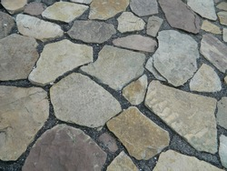 Cobblestone street close up. Gray Cut Stone Wall Background. Abstract wall stone pattern