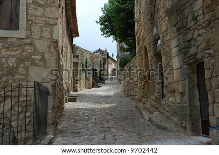 Cobblestoned street lined with stone cottages.