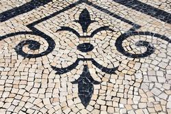 Cobblestones Floral Pattern Handmade pavement (Calçada Portuguesa) in Porto, Portugal.