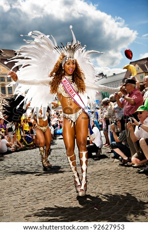 COBURG, GERMANY - JULY 10: An unidentified female samba dancer participates at the annual samba festival in Coburg, Germany on July 10, 2011. - stock photo