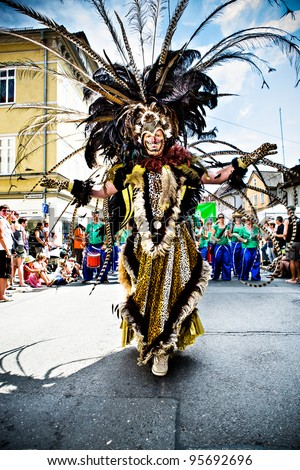 COBURG, GERMANY - JULY 11: An unidentified male samba dancer participates at the annual samba festival in Coburg, Germany on July 11, 2010.