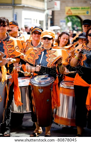 COBURG, GERMANY - JULY 13: The unidentified samba drummers participates at the annual samba festival in Coburg, Germany on July 13, 2008.