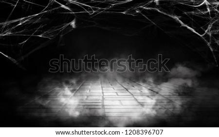 Cobweb in the basement at night, neon light, smoke, fog, concrete, smog. Halloween background