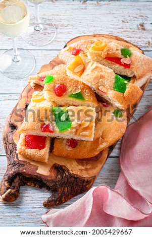 Coca de Sant Joan on wooden board with glasses of champagne on table Photo stock ©