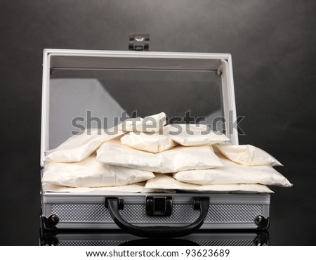 Cocaine in a suitcase on grey background