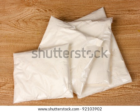 Cocaine in packages on wooden background