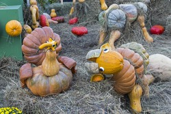 Cock and sheep sculptures made from ripe pumpkins. Festival