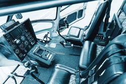 Cockpit helicopter - Instruments panel. Interior of helicopter control dashboard, Heli on the ground. Blue colored