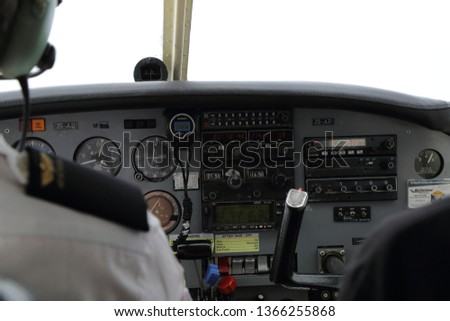 Cockpit instruments in a small aircraft #1366255868