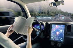 cockpit of autonomous car. a vehicle running self driving mode and a woman driver being relaxed.