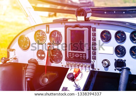 Cockpit of small airplane. Cockpit detail. Cockpit of a small aircraft #1338394337