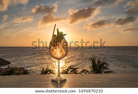 Cocktail at Sunset overlooking the Caribbean Sea on Curacao