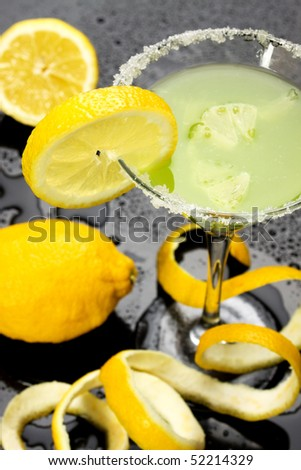Cocktail drink decorated with lemon slice and peel