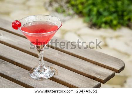 cocktail drink margarita in a garden on a garden table