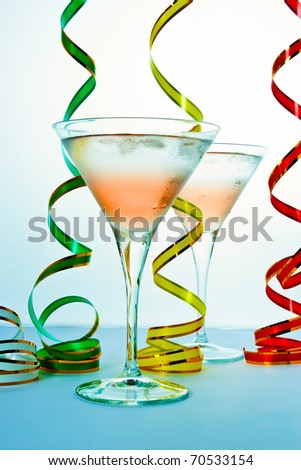 Cocktail glass and ribbons isolated
