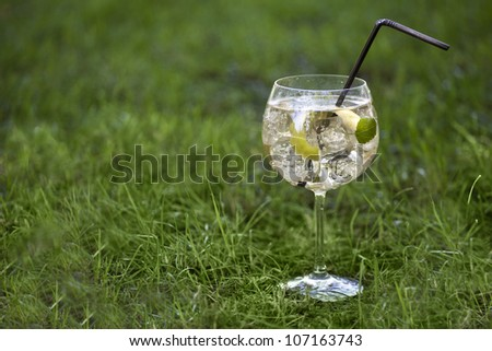 Cocktail glass on a grass background