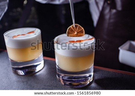 Cocktail on the basis of bourbon and lemon juice. Bar background for the menu. Space for text