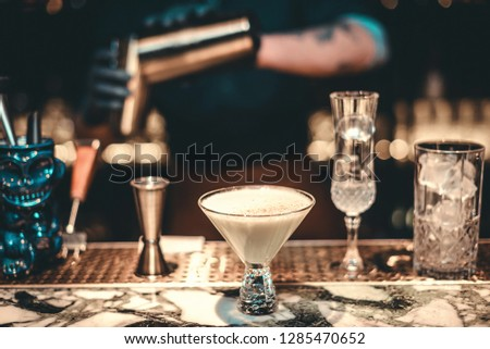 Cocktail Preparation. The barman is preparing a drink.
