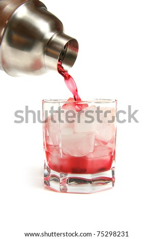 cocktail shaker and glass of red drink with ice cubes