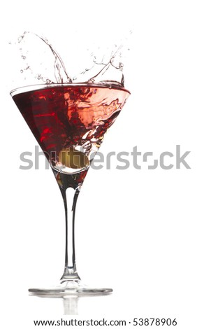 Cocktail splash with an olive on red martini with white background