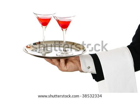 Cocktail waiter carrying two cherry cocktails in glasses on silver tray