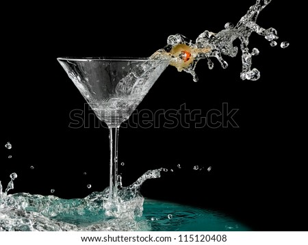 Cocktail with a olive splash in martini glass