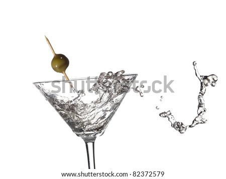 Cocktail with a olive up and splash