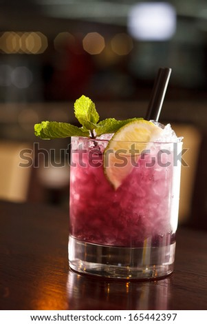 cocktail with blackberries and straw