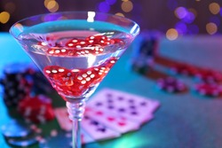 Cocktail with casino dice in glass on table, closeup. Space for text