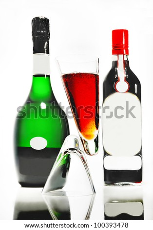 cocktail with champagne with reflection and the bottles for background