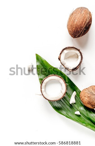 cocktail with coconut on white background top view