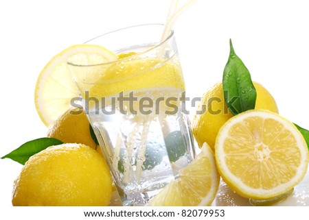Cocktail with fresh wet lemons on white background