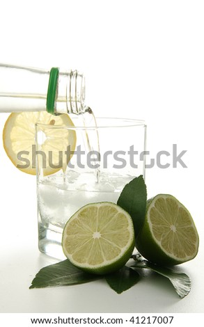cocktail with green lemon on white background