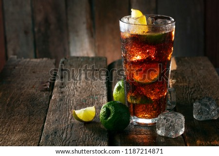 Cocktail with ice coke and lime