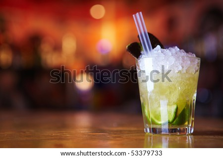Cocktail with lime and ice in a glass