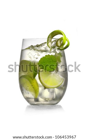 Cocktail with mint and lime in glass on white background #106453967