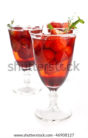 Cocktail with pink wine, liquor and a strawberry on a white
