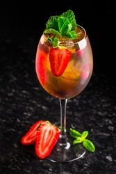 Cocktail with strawberries and mint