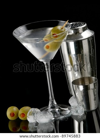 Cocktail with two green olives and ice