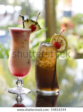 cocktails and drinks, alcoholic, in a tropical setting