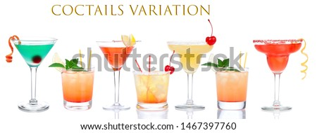 Cocktails composition variation row yellow red alcohol margarita martini cocktails composition with lemon and cherry in cocktail glasses isolated on a white background