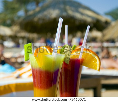 cocktails from fresh fruit in a tall glass with tubes