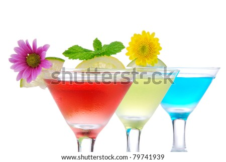 Cocktails martini row with vodka, light rum, gin, tequila, blue curacao, lime juice, lemonade, lemon slice and fresh summer flowers in martinis cocktail glass on a white background