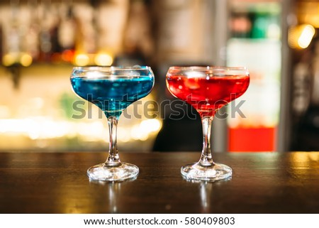 Cocktails on wooden bar counter closeup