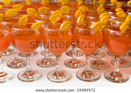 cocktails with martini and a lemon in wineglasses